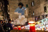 People light candles to honor Diego Maradona, in Naples, Italy, on Nov. 25, 2020. Diego Maradona has died. He was 60. (Alessandro Garofalo/LaPresse via AP)