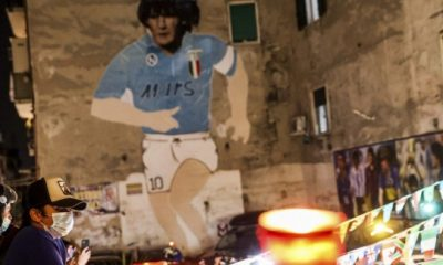 People light candles to honor Diego Maradona, in Naples, Italy, on Nov. 25, 2020. Diego Maradona has died. He was 60. (Alessandro Garofalo/LaPresse via AP)