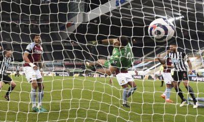 Aston Villa's goalkeeper Emiliano Martinez fails to save the goal from Newcastle