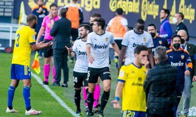 Valencia walk off pitch