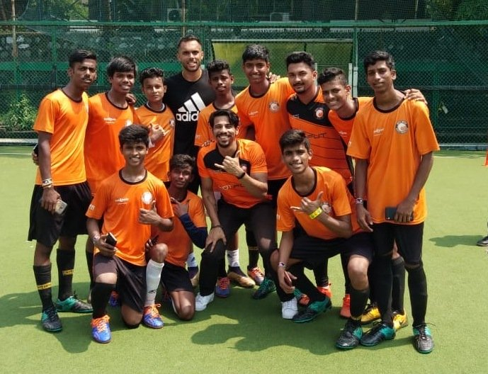 Former Indian Footballer, Robin Singh with local kids from Dharavi at the adidas Tango League in Mumbai